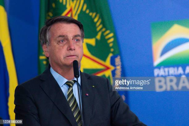 "Jair Bolsonaro, President of Brazil, gets emotional during the ""Brazil Vencendo a COVID"" event amidst the coronavirus pandemic at the Planalto..."