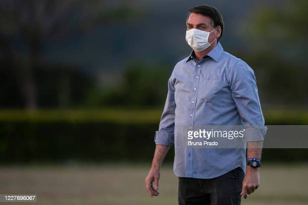 Jair Bolsonaro President of Brazil looks on in front of the official residence after testing positive for coronavirus in Alvorada Palace on July 19...