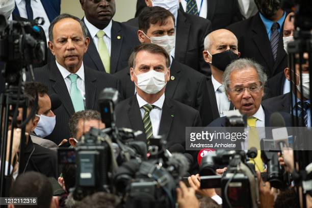 Jair Bolsonaro President of Brazil reacts while Paulo GuedesMinister of Economy of Brazil speaks press after meeting with the Brazilian Supreme Court...