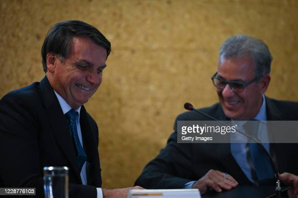 Jair Bolsonaro President of Brazil smiles next to Brazil's Minister of Mines and Energy Bento Albuquerque during the launch ceremony of the Mineracao...