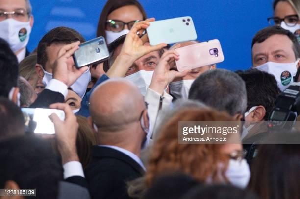 "Jair Bolsonaro President of Brazil stops to take pictures after the ""Brazil Vencendo a COVID"" event amidst the coronavirus pandemic at the Planalto..."