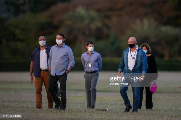 Jair Bolsonaro President of Brazil walks in front of the official residence after testing positive for coronavirus in Alvorada Palace on July 19 2020...