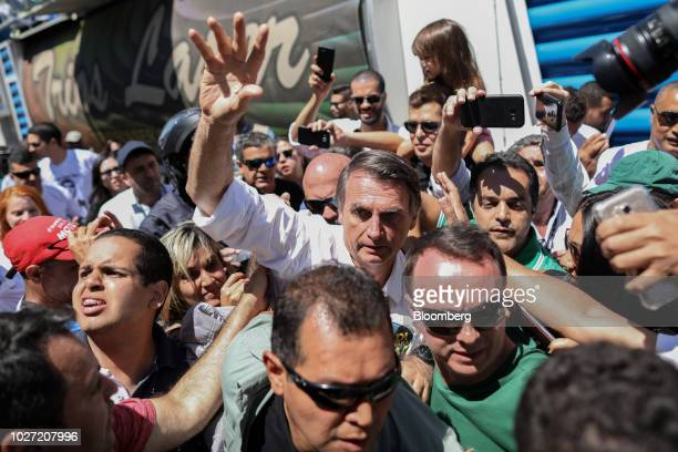 Jair Bolsonaro presidential candidate for the Social Liberal Party waves to supporters during a campaign rally at Taguatinga Brazil on Wednesday Sep...