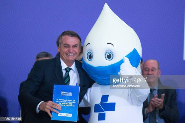 "Jair Bolsonaro President of Brazil poses for pictures with ""Zé Gotinha"", symbol of vaccination in Brazil, during Launch of the National Vaccine..."