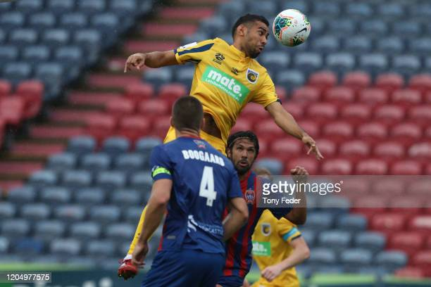 Jair Britto of the Central Coast Mariners contests a header during the round 18 A-League match between the Newcastle Jets and the Central Coast...