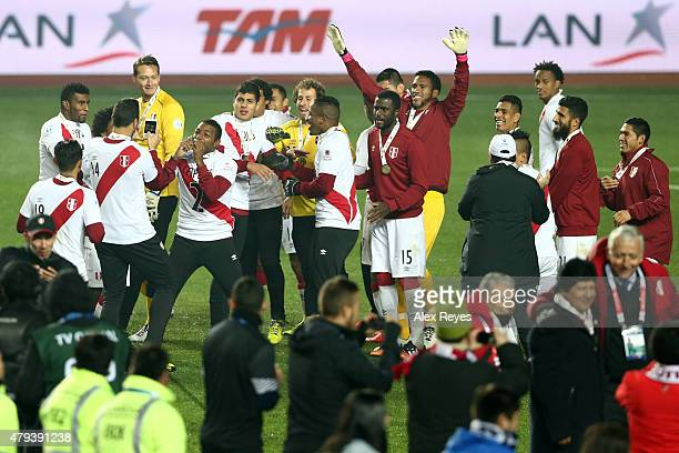 Jair Cespedes of Peru kisses his third place medal while his teammate Claudio Pizarro takes a photo the 2015 Copa America Chile Third Place Playoff...