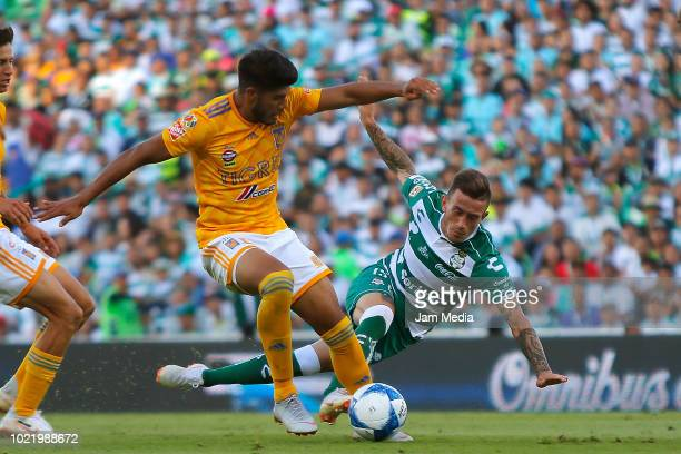 Jair Diaz of Tigres and Bryan Lozano of Santos fight for the ball during the fifth round match between Santos Laguna and Tigres UANL as part of the...