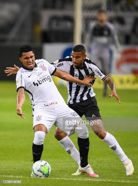 Jair of Atletico MG and Éderson of Corinthians battle for the ball during a match between Atletico MG and Corinthians as part of Brasileirao Series A...