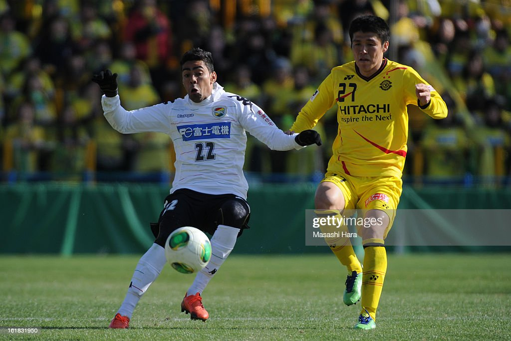 Jair #22 of JEF United Chiba (L) and Kim Chang Soo #27 of Kashiwa Reysol compete for the ball during the pre season friendly between Kashiwa Reysol and JEF United Chiba at Hitachi Kashiwa Soccer Stadium on February 17, 2013 in Kashiwa, Japan.