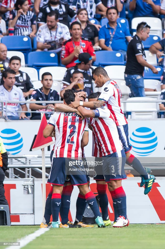 Jair Pereira of Chivas celebrates with teammates after scoring his team's first goal during the 4th round match between Monterrey and Chivas as part of the Torneo Apertura 2017 Liga MX at BBVA Bancomer Stadium on August 12, 2017 in Monterrey, Mexico.