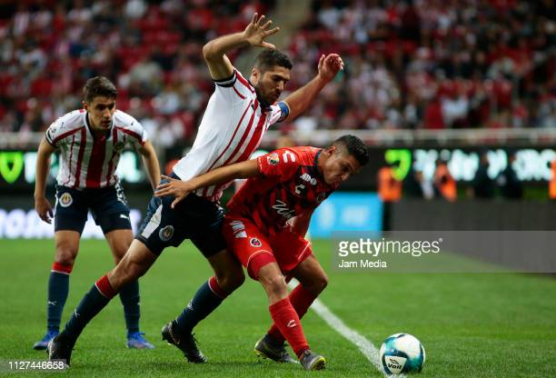 Jair Pereira of Chivas fights for the ball with Jesus Paganoni of Veracruz during the fifth round match between Chivas and Veracruz as part of the...