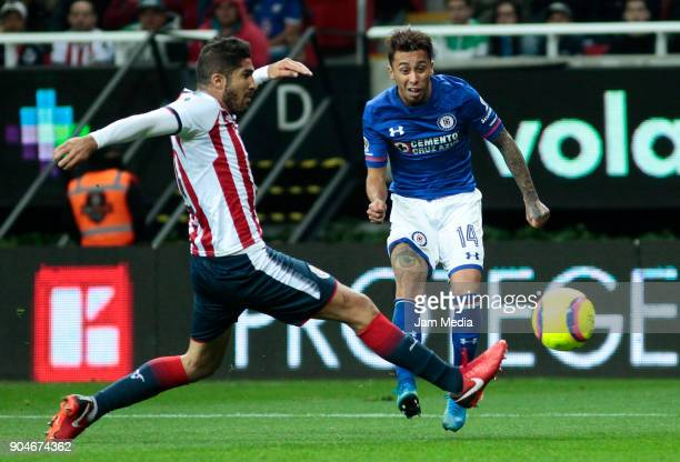 Jair Pereira of Chivas tries to block a shot by Martin Rodriguez of Cruz Azul during the 2nd round match between Chivas and Cruz Azul as part of the...