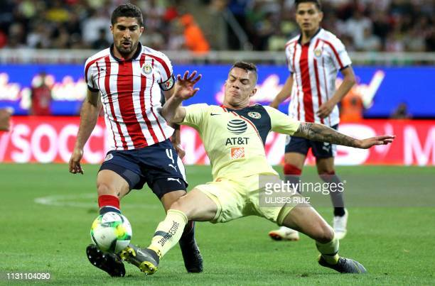 Jair Pereira of Guadalajara and Colombian Mateus Uribe of America vie for the ball during their Mexican Clausura football tournament match at the...