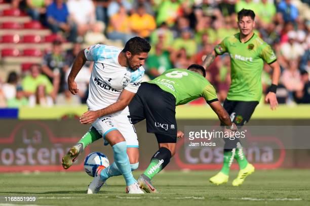 Jair Pereira of Queretaro fights for the ball with Dario Lezcano of Juarez during the 5th round match between FC Juarez and Queretaro as part of the...