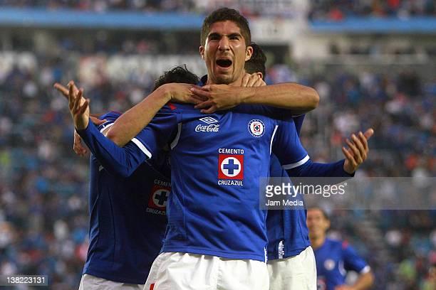 Jair Pereyra of Cruz Azul celebrates with teammates a scored goal against Jaguares during a match between Cruz Azul v Jaguares as part of the...