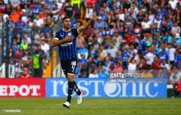 Jair Pereyra of Queretaro celebrates after scoring the third goal of his team during the 3rd round match between Queretaro and Cruz Azul as part of...