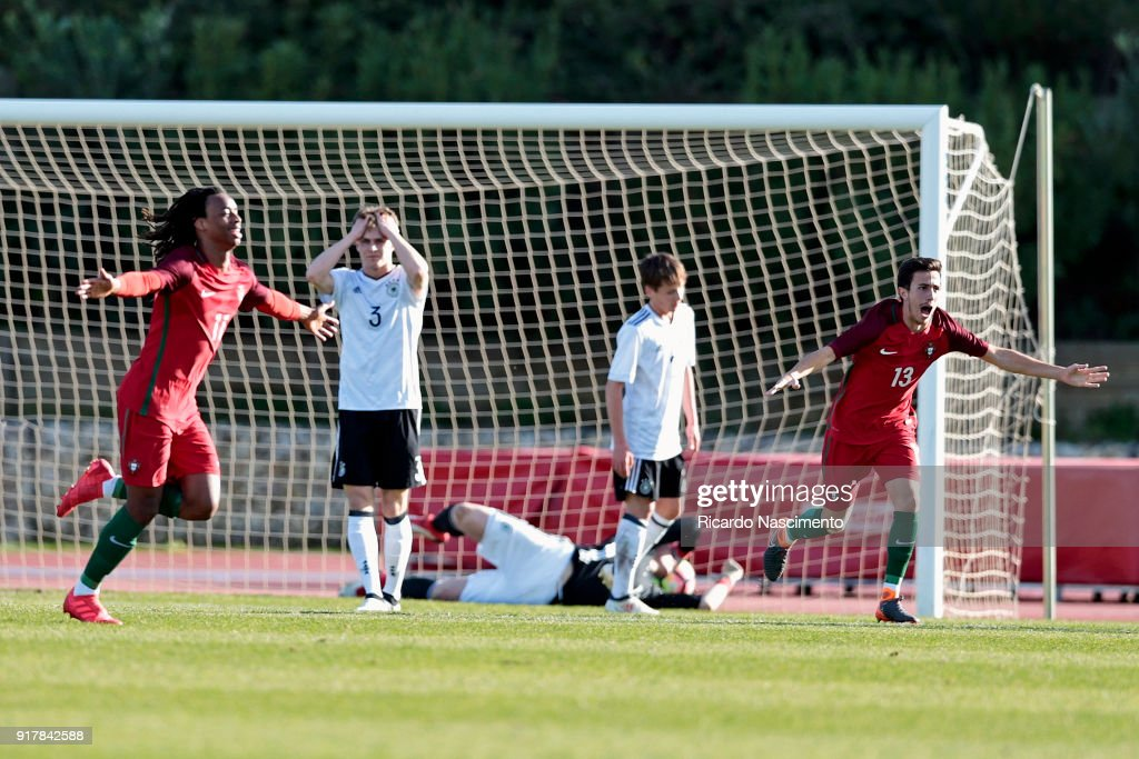 Jair Tavares (L) scores for Portugal and celebrates with Francisco Saldanha (R) of Portugal U17 during U17-Juniors Algarve Cup match between U17 Portugal and U17 Germany at Bela Vista Stadium on February 13, 2018 in Parchal, Portugal.