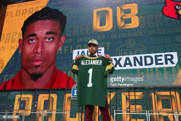Jaire Alexander of Louisville poses after being picked overall by the Green Bay Packers during the first round of the 2018 NFL Draft at ATT Stadium...
