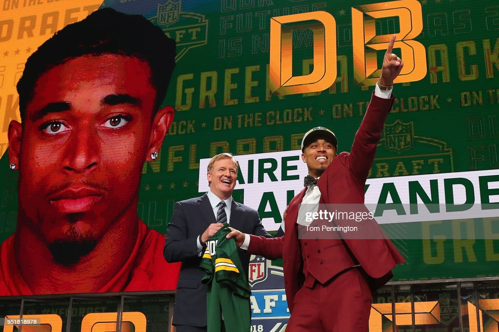 Jaire Alexander of Louisville reacts with NFL Commissioner Roger Goodell after being picked #18 overall by the Green Bay Packers during the first round of the 2018 NFL Draft at AT&T Stadium on April 26, 2018 in Arlington, Texas.