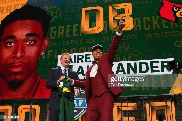 Jaire Alexander of Louisville reacts with NFL Commissioner Roger Goodell after being picked overall by the Green Bay Packers during the first round...