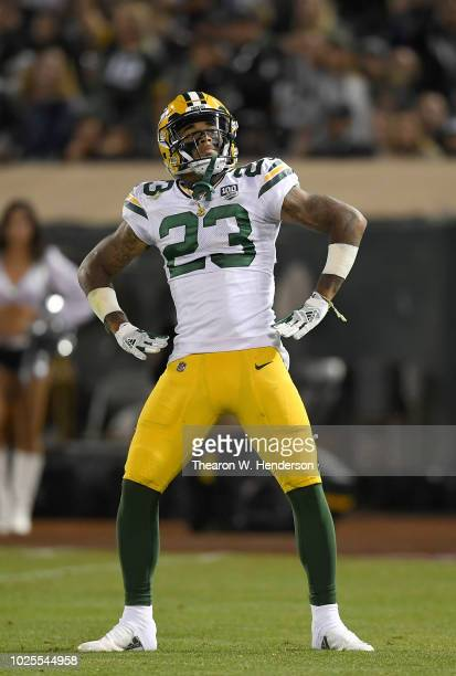 Jaire Alexander of the Green Bay Packers celebrates after he intercepts a pass against the Oakland Raiders during the second quarter of an NFL...