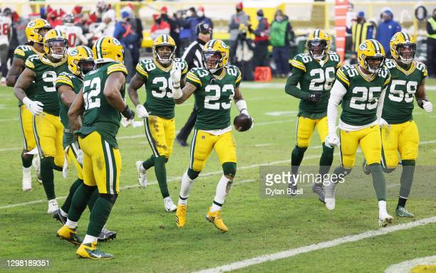 Jaire Alexander of the Green Bay Packers celebrates his interception in the fourth quarter against the Tampa Bay Buccaneers during the NFC...