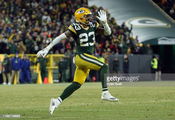 Jaire Alexander of the Green Bay Packers celebrates making a sack on a 2point conversion against the Seattle Seahawks in the second half of the NFC...