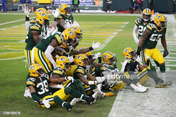 Jaire Alexander of the Green Bay Packers celebrates with teammates after his interception in the fourth quarter against the Tampa Bay Buccaneers...