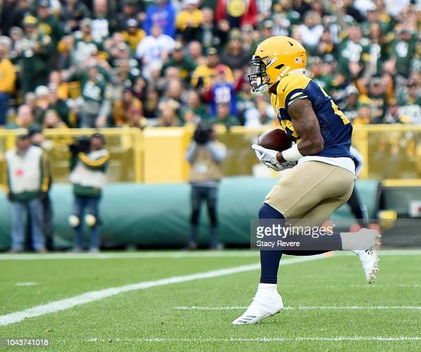 Jaire Alexander of the Green Bay Packers intercepts a pass thrown by Josh Allen of the Buffalo Bills during the second quarter of a game at Lambeau...