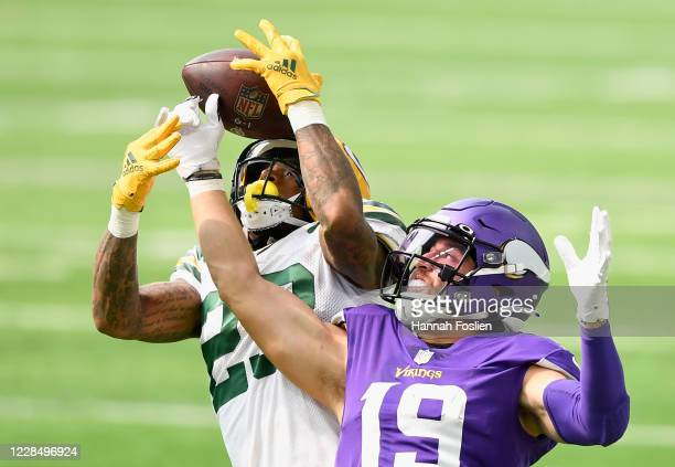 Jaire Alexander of the Green Bay Packers intercepts the ball against Adam Thielen of the Minnesota Vikings during the second quarter of the game at...