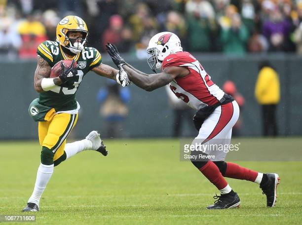 Jaire Alexander of the Green Bay Packers is tackled by Brandon Williams of the Arizona Cardinals on a punt return during the first half of a game at...