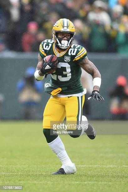 Jaire Alexander of the Green Bay Packers returns a punt for yards during a game against the Arizona Cardinals at Lambeau Field on December 02 2018 in...