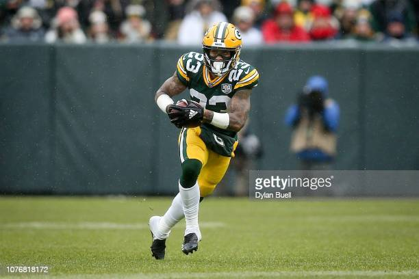 Jaire Alexander of the Green Bay Packers runs with the ball in the second quarter against the Arizona Cardinals at Lambeau Field on December 02 2018...