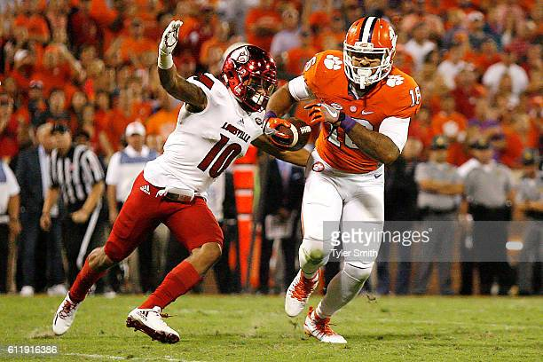 Jaire Alexander of the Louisville Cardinals forces a fumble from Jordan Leggett of the Clemson Tigers during the third quarter at Memorial Stadium on...