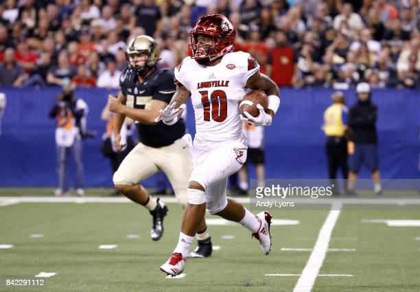 Jaire Alexander of the Louisville Cardinals runs with the ball during the game against the Purdue Boilermakers at Lucas Oil Stadium on September 2...