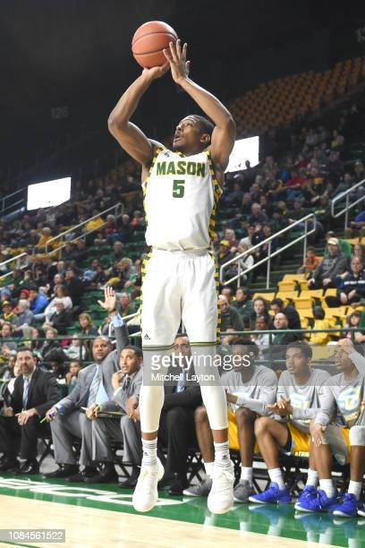 Jaire Grayer of the George Mason Patriots takes a jump shot during a college basketball game against the Southern University Jaguars at the Eagle...