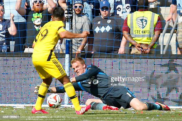 Jairo Arrieta of Columbus Crew has his shot on goal blocked by Eric Kronberg of Sporting KC early in the second half May 4 2014 at Sporting Park in...