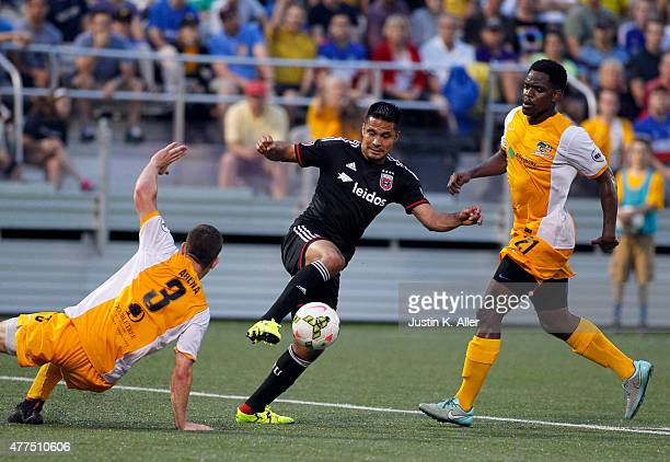 Jairo Arrieta of DC United battles for a ball against Anthony Arena and Fejiro Okiomah of the Pittsburgh Riverhounds in the second half during the...