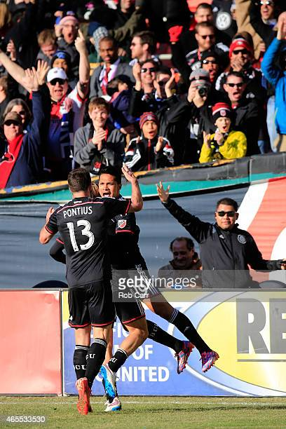 Jairo Arrieta of DC United celebrates with Chris Pontius after scoring a second half goal against the Montreal Impact during their 10 win at RFK...