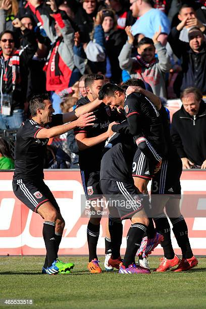Jairo Arrieta of DC United celebrates with teammates after scoring a second half goal against the Montreal Impact during their 10 win at RFK Stadium...