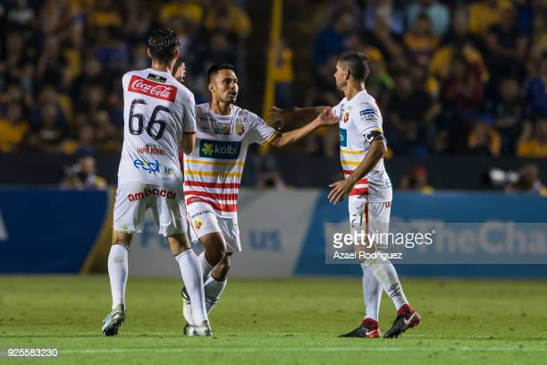 Jairo Arrieta of Herediano celebrates with teammates after scoring the first goal of his team during the second leg match between Tigres UANL and...
