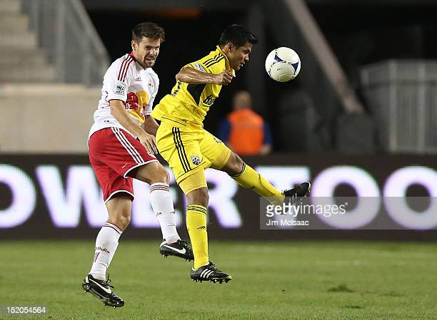 Jairo Arrieta of the Columbus Crew controls the ball against Heath Pearce of the New York Red Bulls at Red Bull Arena on September 15 2012 in...