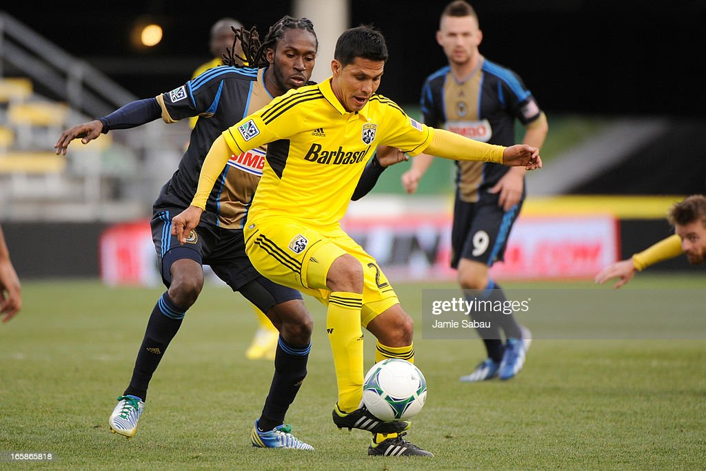 Jairo Arrieta #25 of the Columbus Crew maintains control of the ball in front of Keon Daniel #26 of the Philadelphia Union in the second half on April 6, 2013 at Crew Stadium in Columbus, Ohio. Columbus and Philadelphia played to a 1-1 tie.