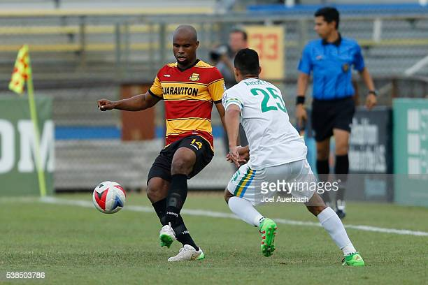Jairo Arrieta of the New York Cosmos defends against Julius James of the Fort Lauderdale Strikers as he brings the ball upfield during first half...