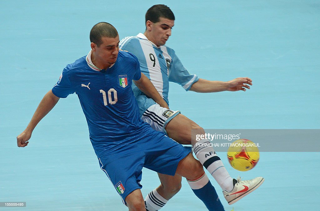 Jairo Dos Santos of Italy (L) battles for the ball with Cristian Borruto of Argentina (R) during their first round football match of the FIFA Futsal World Cup 2012 in Bangkok on November 5, 2012.