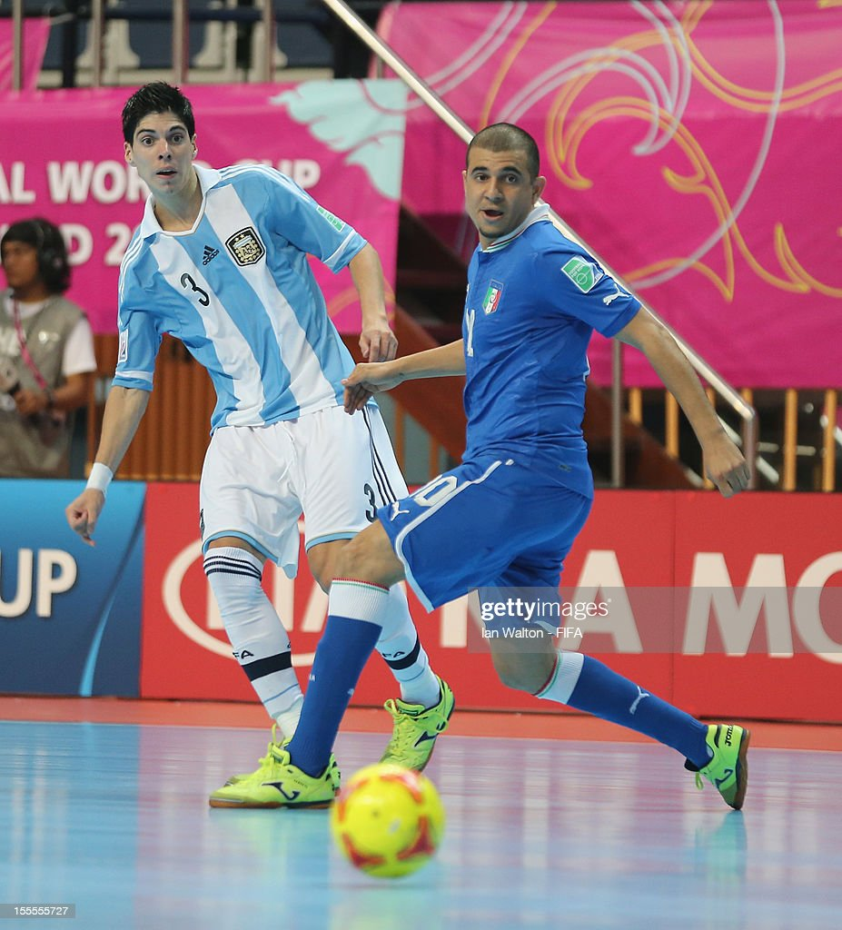 Jairo Dos Santos of Italy tries to tackle Matias Lucuix of Argentina during the FIFA Futsal World Cup Thailand 2012, Group D match between Argentina and Italy at Nimibutr Stadium on November 5, 2012 in Bangkok, Thailand.