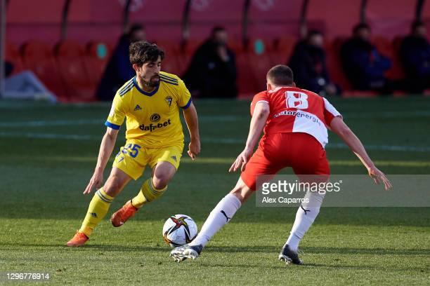 Jairo Izquierdo of Cadiz CF dribbles Sebastian Carlos Cristoforo of Girona FC during the Copa del Rey round of 32 match between Girona FC and Cadiz...