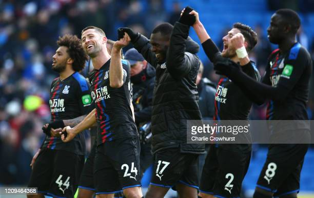 Jairo Riedewald Gary Cahill Christian Benteke Joel Ward and Cheikhou Kouyate of Crystal Palace celebrate following their sides victory after the...