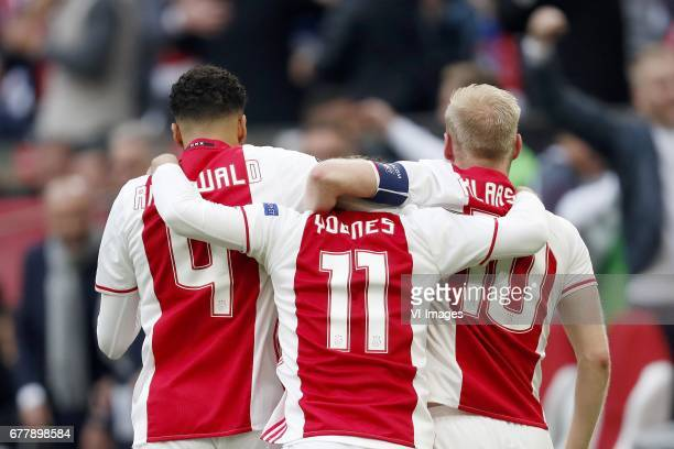 Jairo Riedewald of Ajax Amin Younes of Ajax Davy Klaassen of Ajaxduring the UEFA Europa League semi final match between Ajax Amsterdam and Olympique...
