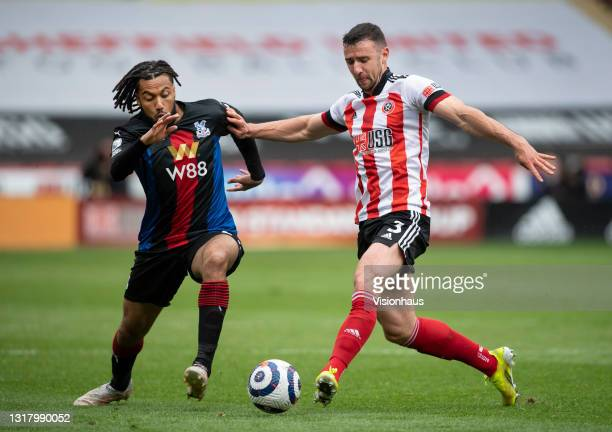 Jairo Riedewald of Crystal Palace and Enda Stevens of Sheffield United in action during the Premier League match between Sheffield United and Crystal...